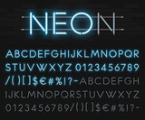 Fototapety Realistic neon alphabet on a background of black brick wall. Blue glowing font. Vector format