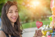 Smiling beautiful young woman with lollipops