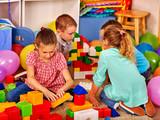 Group children game blocks on floor in primary school. Top view class of primary school.