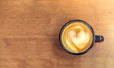 Vintage filtered,Top view of white coffee cup with heart shape l