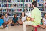 Fototapety Teacher teaching kids in library