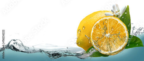 Juicy, ripe citrus lemon on a background of splashing water.
