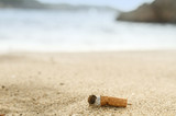 Cigarette butts in the sand on beach