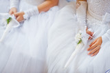 Hands with candles of little girls on first holy communion - 116240258