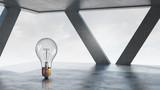 Light bulb in modern office . Mixed media