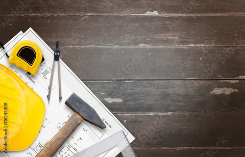 House construction tools on wooden table with free space for text.