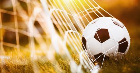 Soccer ball in goal © Maksim Pasko