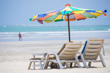 beach chair with colorful umbrella
