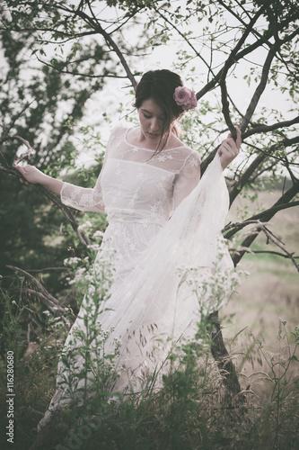 Zdjęcia na płótnie, fototapety, obrazy : young woman in white lacy dress