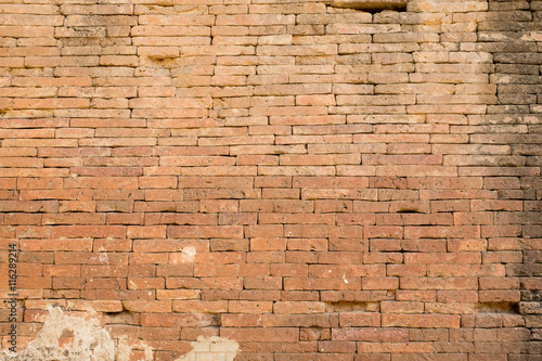 Close up clay orange brick wall texture background