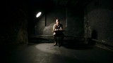 Sad soldier in uniform looking and sitting in dirty empty room