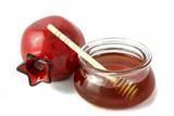 Ceramic pomegranate and honey pot. Isolated