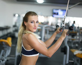 Woman doing exercise on triceps machine