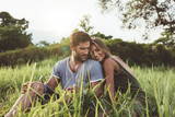 Fototapety Romantic young couple in meadow