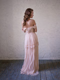 Fashion portrait of beautiful woman in a long pink dress.
