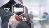 A businessman selecting a Demo Concept button on a hexagonal screen