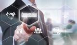 A businessman selecting a Compensation Concept button on a hexagonal screen