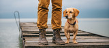 Fototapety Man and his dog standing on dock
