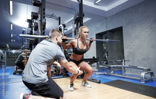 Plakát, Obraz man and woman with bar flexing muscles in gym