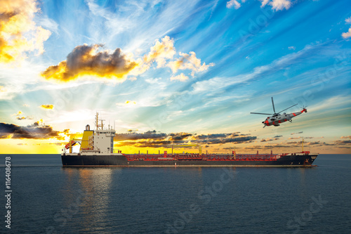 fototapeta na ścianę Coastguard rescue helicopter is approaching the ship.