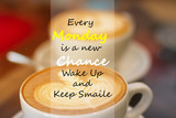 Every Monday is a New Chance wake up and keep smile. Inspirational Quote in blur a cup of coffee on wooden background.
