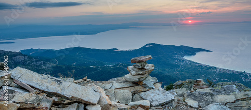 Zdjęcia na płótnie, fototapety, obrazy : Thassos Island, Greece - view from Mount Ipsarion - little stone pagoda in the middle and first rays of the rising sun