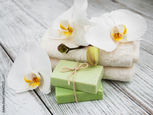 Spa products and white orchids плакат