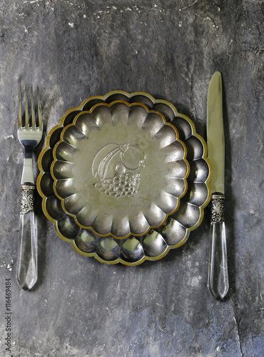 obraz PCV vintage cutlery and a plate on a gray background