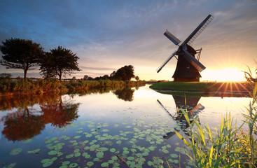 summer sunrise behind Dutch windmill