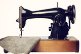 Retro sewing machine and gray leather isolated on white. Front view.