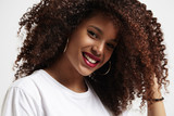 beauty smiling black woman with amazing afro curly hair