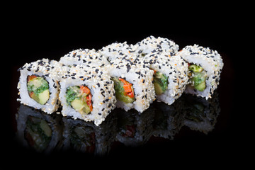 Japanese rolls on black background