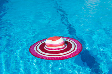 Pink sunhat at swimming pool