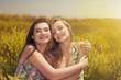 two beautiful young women having fun in the nature