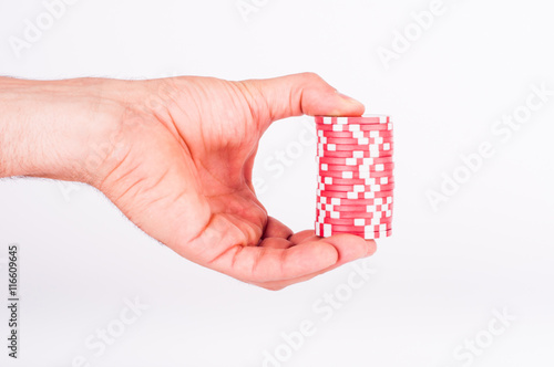 Red casino chips on human hands isolated on white плакат
