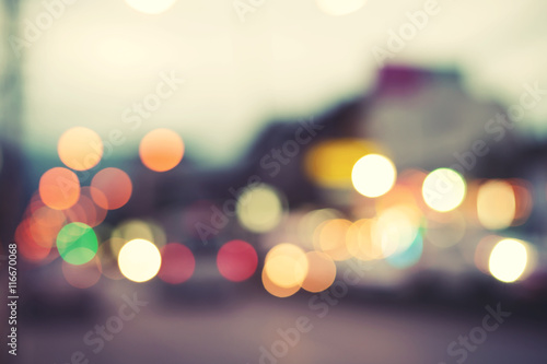 Artistic style - Defocused urban abstract blurred bokeh lights. City blurring light in the background for your design, vintage or retro color tone style. - 116670068