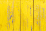 Fototapety Vertical background of the wooden planks with cracked yellow paint