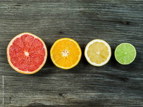 Fruit on wood background in a row