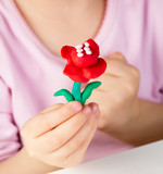 Child hands  with colorful clay - 116756423