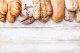 Fototapety Delicious fresh bread on wooden background