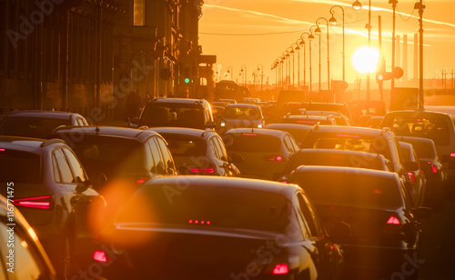 Foto op Plexiglas New York TAXI Cars are in traffic jam during a beautiful golden sunset.