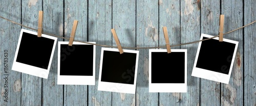 Fototapeta five blank instant photos hanging on the clothesline