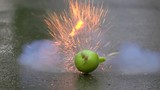 Green apple exploding. 500 fps super slow motion shot