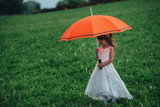 little beautiful girl with bride dress