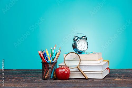 Stampa su Tela Back to School concept. Books, colored pencils and clock