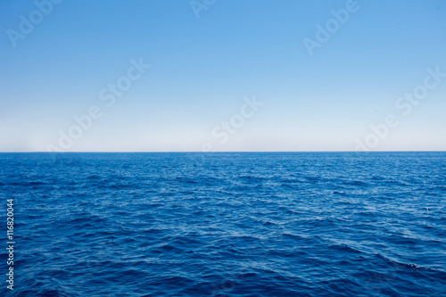 Poster Oceanië Background of sparkling sea water on a bright sunny day. Sea and sky