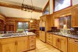 Log cabin kitchen interior design with honey color cabinets. - 116858011