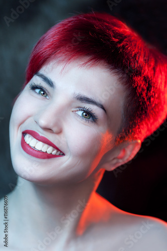 Beautiful young redhead woman Poster