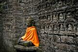 Ancient Buddha statue in orange cover