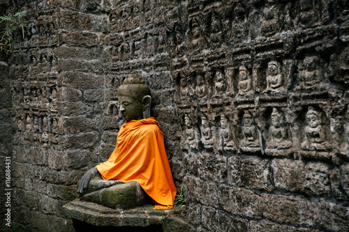 Poster Ancient Buddha statue in orange cover